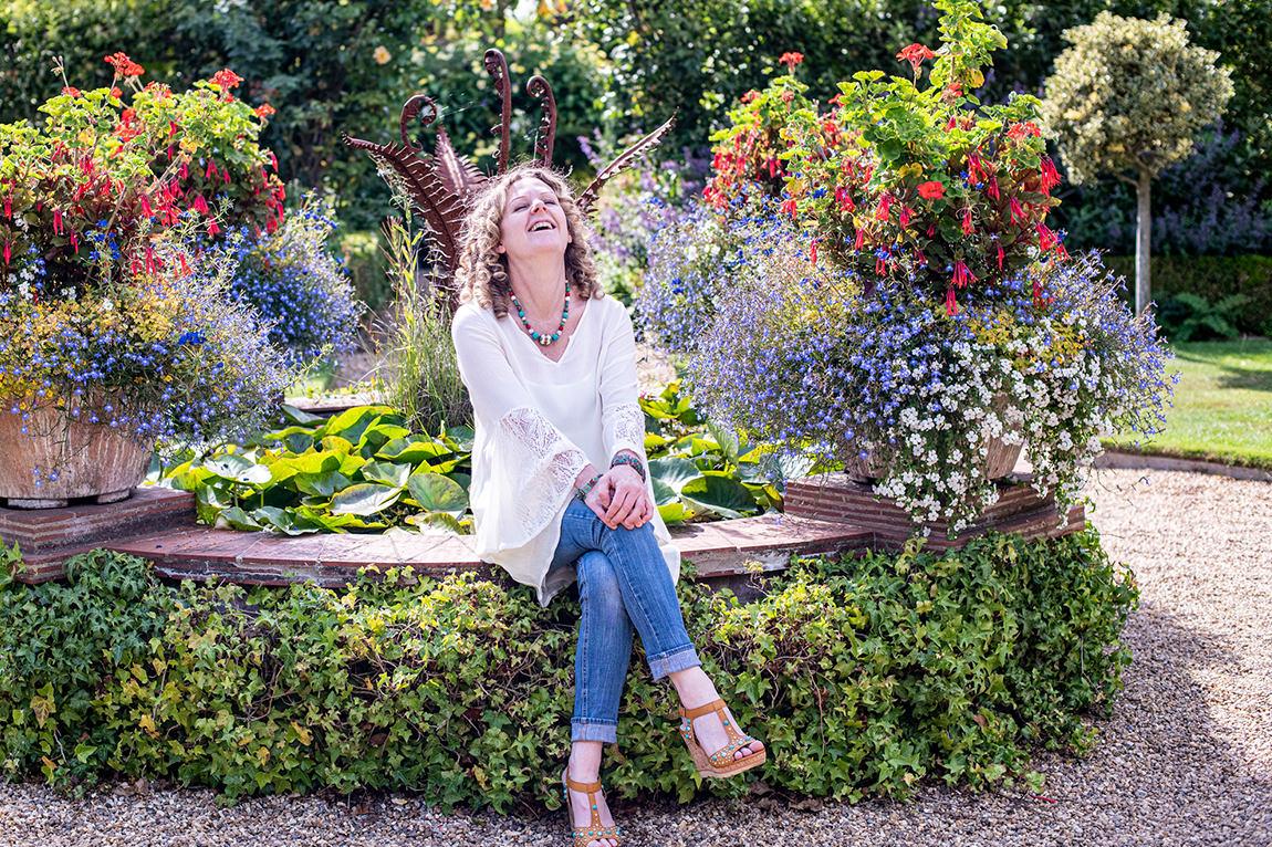 karen among flowers summer laughing