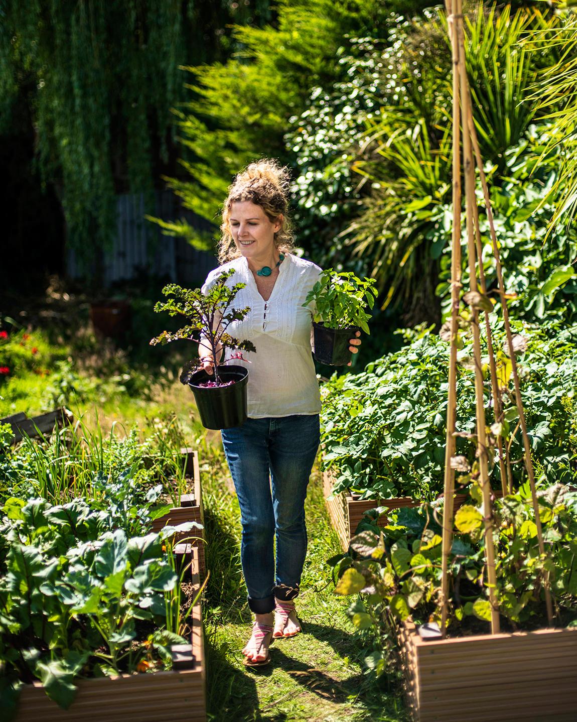 karen with vegetables in permaculture home garden